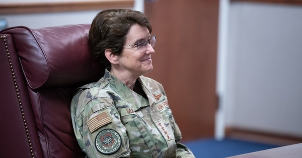 Gen. Jacqueline D. Van Ovost, the head of Air Mobility Command, receives a mission briefing during her visit to the 349th Air Mobility Wing headquarters at Travis Air Force Base, California, Sept. 1. (Dennis Santarinala/Air Force)