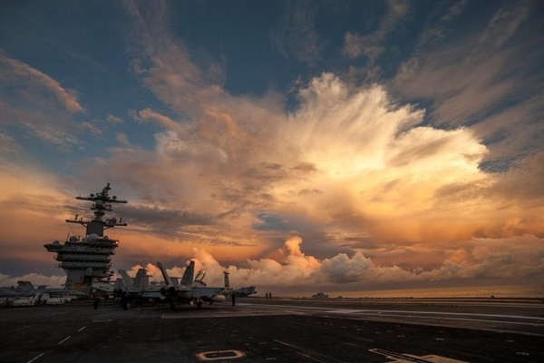 The aircraft carrier USS Carl Vinson (CVN 70) transits the Pacific Ocean during Valiant Shield 2014 Sept. 18, 2014. Valiant Shield is a biennial U.S. Air Force, Navy and Marine Corps exercise held in Guam, focusing on real-world proficiency in sustaining joint forces at sea, in the air, on land and in cyberspace. (DoD photo by Mass Communication Specialist 2nd Class John Philip Wagner Jr., U.S. Navy/Released)