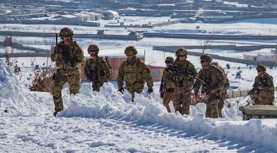U.S. soldiers hike up a snow-covered hill to take part in a key leader engagement Jan. 16, 2020, in southeastern Afghanistan. (Staff Sgt. Nicholas Brown-Bell/Army)