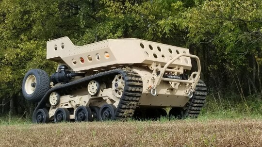 Designed for all-terrain travel, the tracked Grizzly is first and foremost a cargo beast of burden. (Textron)