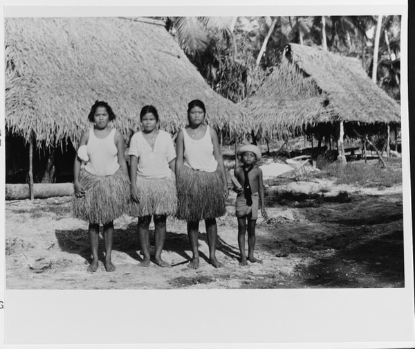 Three local women and a boy at a Makin village, shortly after the U.S. invasion of late November 1943. (National Archives)