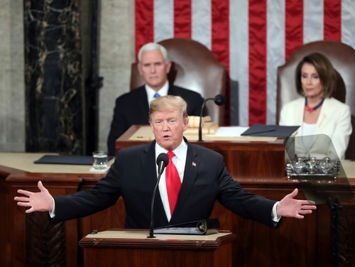 President Donald Trump delivers his State of the Union address to a joint session of Congress on Capitol Hill in Washington, as Vice President Mike Pence and Speaker of the House Nancy Pelosi, D-Calif., watch on Feb. 5, 2019. (Andrew Harnik/AP)