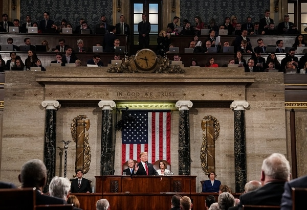 President Donald Trump, with House Speaker Nancy Pelosi and Vice President Mike Pence looking on, delivers the State of the Union address in the House of Representatives chamber at the Capitol on Feb. 5, 2019, in Washington. (Doug Mills-Pool/Getty Images)