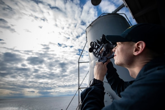 Quartermaster 2nd Class Andrew Burgess takes a sextant reading on the Wasp-class amphibious assault ship USS Kearsarge (LHD-3) Jan. 6, 2019, in the Mediterranean Sea. (MC1 Mike DiMestico/Navy)