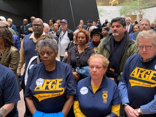 Members of the American Federation of Government Employees stood for 20 minutes in silence at the Hart Senate Office Building to protest Trump administration workforce policies. (Jessie Bur/Staff)