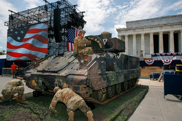 An Army soldier hops out of a Bradley Fighting Vehicle after moving it into place by the Lincoln Memorial, Wednesday, July 3, 2019, in Washington, ahead of planned Fourth of July festivities with President Donald Trump. (Jacquelyn Martin/AP)