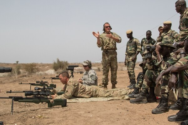 Master Sgt. Mac Broich, an instructor with the Vermont National Guard's Regional Training Institute, instructs Senegalese soldiers at a advanced marksmanship range July 17, 2016, in Thies, Senegal. (Spc. Craig Philbrick/Army)