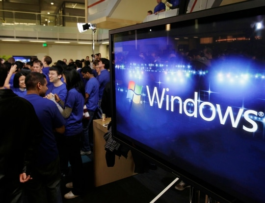 With Windows 7 going out of support in January, agencies must upgrade to Windows 10. (Ted S. Warren/AP)