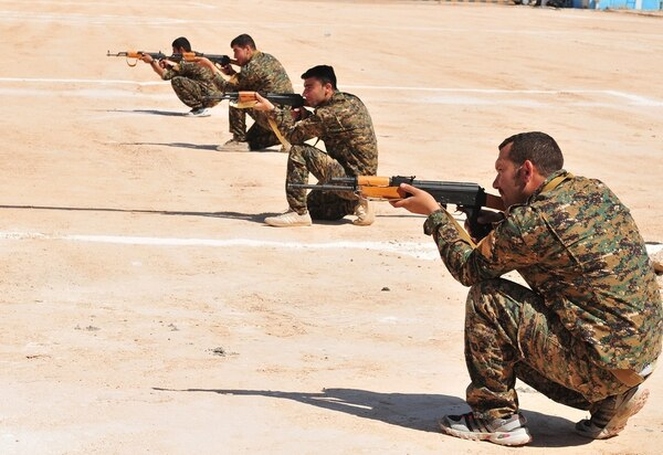 Members of the Manbij Military Council pull security during a training scenario in Manbij, Syria, Aug. 16, 2018. (Sgt. Nicole Paese/Army)