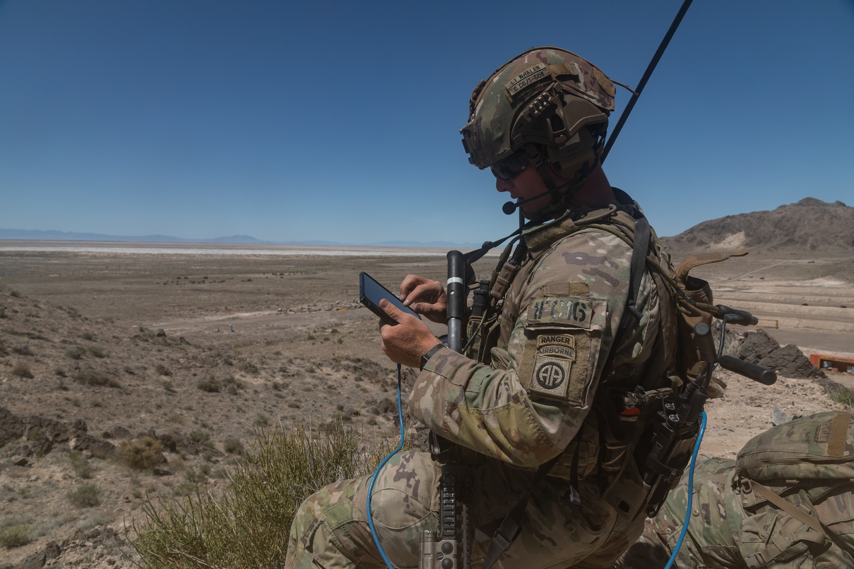 A dismounted soldier is able to take control of a nearby air-launched effects asset using a tablet to check out a blind spot as his unit attempts to seize enemy terrain. (Courtesy of the U.S. Army)