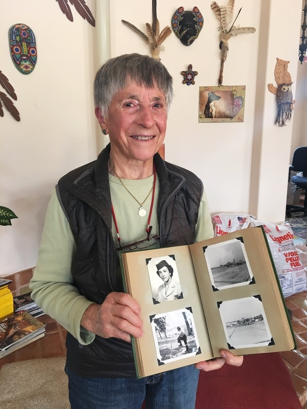 At her California home, Helen James holds a photo album of her service with the Air Force. (Courtesy of Legal Aid at Work)