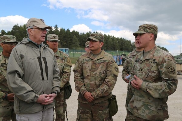 Bruce Jette, left, assistant secretary of the Army for acquisition, logistics and technology, talks to soldiers from the 2nd Cavalry Regiment at Hohenfels, Germany, April 26, 2018. (Staff Sgt. Kalie Frantz/Army)
