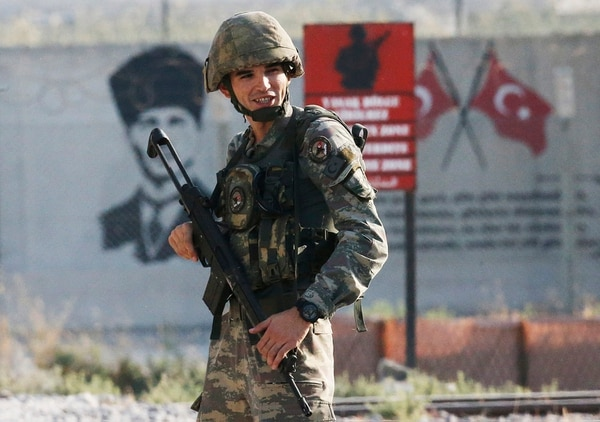 A Turkish soldier stands at the border with Syria in Akcakale, Sanliurfa province, southeastern Turkey, Wednesday, Oct. 9, 2019. (Lefteris Pitarakis/AP)