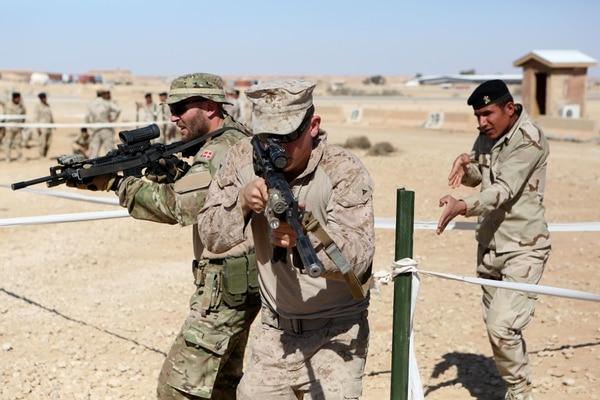 U.S. Marines and coalition forces with Task Force Al Asad teach Iraqi soldiers Military Operations on Urban Terrain techniques aboard Al Asad Air Base, Iraq, Feb. 14-16, 2015. The three-day training period utilized different MOUT facilities in order to teach Iraqi soldiers basic room clearing techniques, how to move across linear danger areas as a squad, and the proper way to maneuver through a building in fire teams. (U.S. Marine Corps photo by Cpl. Tony Simmons/RELEASED)
