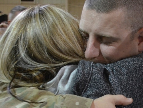A new report on Army spouses recommends finding ways to better inform them of resources that are available to assist them in navigating military life. (Army)