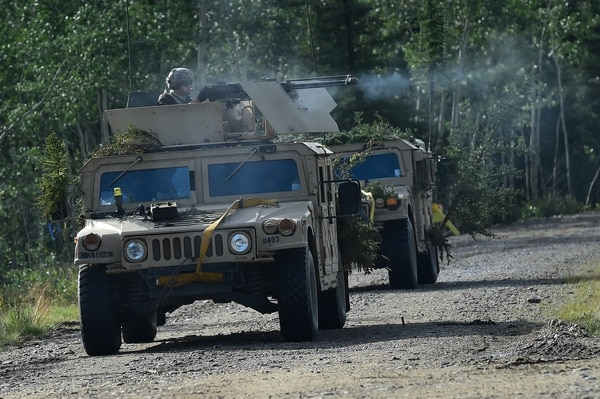Opposing Forces attack Soldiers assigned to A Company, 1st Battalion, 24th Infantry Regiment, 1st Stryker Brigade Combat Team, 25th Infantry Division, U.S. Army Alaska, in Donnelly Training Area near Ft. Greely, Alaska during Arctic Anvil 2016, Monday, July 25, 2016. Arctic Anvil is a joint, multinational exercise which includes forces from USARAK's 1st Stryker Brigade Combat Team, 25th Infantry Division and UATF, along with forces from the 196th Infantry Brigade's Joint Pacific Multinational Readiness Capability, the Iowa National Guard's 133rd Infantry Regiment and the 1st Battalion, Princess Patricia's Canadian Light Infantry. (U.S. Air Force photo/Justin Connaher)