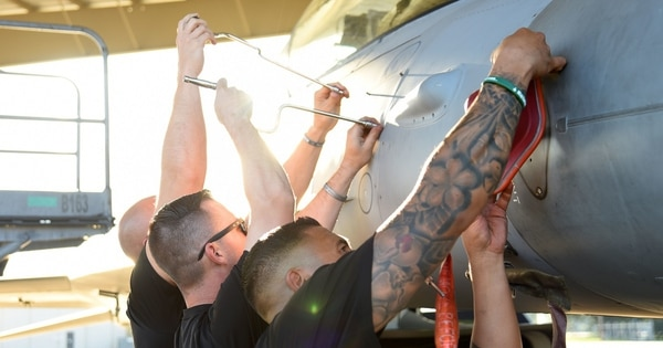 From left, Tech. Sgts. Kam Glowacki, Dominic Dizes and Luis Lopez prepare an F-16D Fighting Falcon for flight at Shaw Air Force Base, S.C., Sept. 25. (Senior Airman Kathryn Reaves/Air Force))