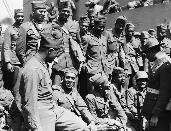 Black Chaplin shown wearing campaign hat talking to colored troops. On way to fighting zone on August 3, 1942. (AP Photo)
