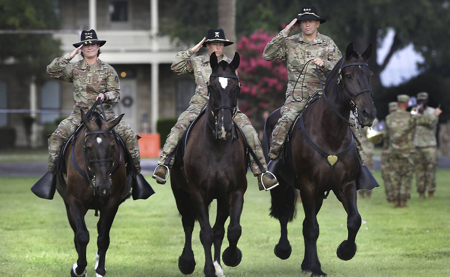 Lt. Gen. Jeffrey Buchanan, right, outgoing commander of U.S. Army North, and Lt. Gen Laura Richardson, left, incoming commander, ride with Col. Niave Knell, U.S. Army North chief of staff, to review the troops during the change of command at Fort Sam Houston on July 8, 2019.