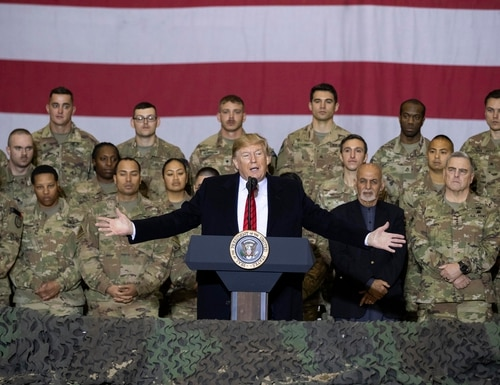 President Donald Trump, center, with Afghan President Ashraf Ghani and Joint Chiefs Chairman Gen. Mark Milley, behind him at right, addresses members of the military during a surprise Thanksgiving Day visit on Nov. 28, 2019, at Bagram Air Field in Afghanistan. (Alex Brandon/AP)