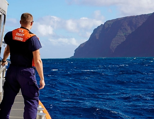 Coast Guard cutter William Hart moves toward the Na Pali Coast on the Hawaiian island of Kauai on Friday, the day after a tour helicopter disappeared with seven people aboard. Authorities say wreckage of the helicopter has been found in a mountainous area on the island. (Lt. j.g. Daniel Winter/Coast Guard via AP)