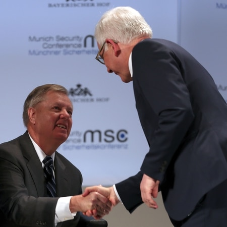 U.S. Senator Lindsey Graham, left, shakes hands with Poland's foreign minister, Jacek Czaputowicz, before a panel discussion at the 55th Munich Security Conference on Feb. 15, 2019, in Munich, Germany. (Alexandra Beier/Getty Images)