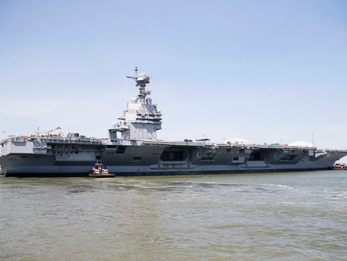 NEWPORT NEWS, Va. (June 11, 2016) -- Tug boats maneuver Pre-Commissioning Unit Gerald R. Ford (CVN 78), into the James River during the ship's Turn Ship evolution. This is a major milestone that brings the country's newest aircraft carrier another step closer to delivery and commissioning later this year. (Photo by Mass Communication Specialist 3rd Class Cathrine Mae O. Campbell)