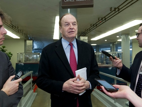 Sen. Richard Shelby, R-Ala., speaks with reporters as he walks to the Senate chamber on Feb. 9. On Tuesday, Shelby was named chairman of the Senate Appropriations Committee, where he will also serve as the head of its defense subcommittee. (Jose Luis Magana/AP)