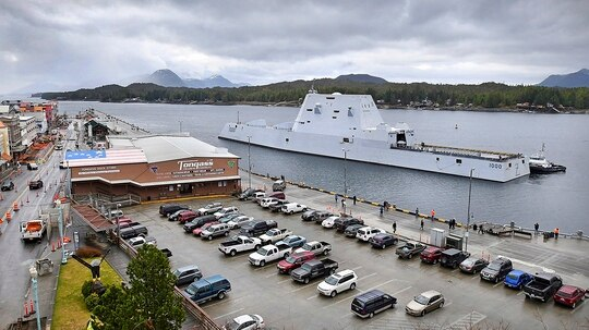 In this Saturday, March 23, 2019, photo, assisted by tugs in Tongass Narrows, the U.S. Navy guided missile destroyer USS Zumwalt approaches Berth 2 in Ketchikan, Alaska. The ship was scheduled for a multi-day visit in the First City. (Dustin Safranek/Ketchikan Daily News via AP)