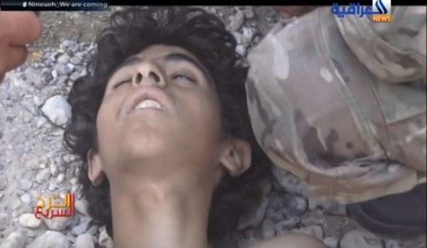 The seriously wounded Islamic State fighter, believed to be between 15 and 17 years of age, military prosecutors believe was murdered by a Navy SEAL. (screen shot of YouTube video used as evidence in criminal hearing)