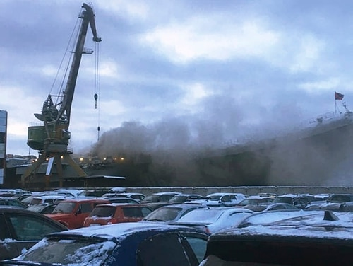 Smoke billows from the Admiral Kuznetsov carrier during a Thursday fire in Murmansk, Russia,. (Anonymous Source via AP)
