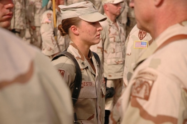 Then-Sgt. Leigh Ann Hester stands at attention before receiving her Silver Star. (Spc. Jeremy D. Crisp/Army)
