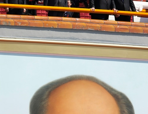 From left, Russian President Vladimir Putin, Chinese President Xi Jinping, former Chinese President Jiang Zemin and former Chinese President Hu Jintao stand on top of a portrait of late chairman Mao Zedong as they attend a military parade to commemorate the 70th anniversary of the end of World War II, in Beijing Thursday, Sept. 3, 2015. (Jason Lee/Pool Photo via AP)