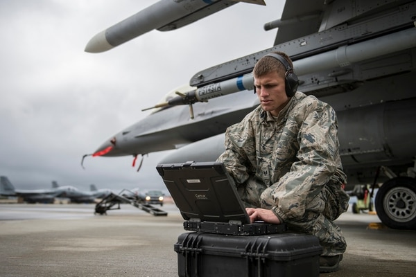 Staff Sgt. Zackery Coder, a crew chief, checks computer data to make sure the F-16 Fighting Falcon was ready for the next sortie during a Red Flag exercise in Alaska. (Senior Airman Peter Reft/Air Force)