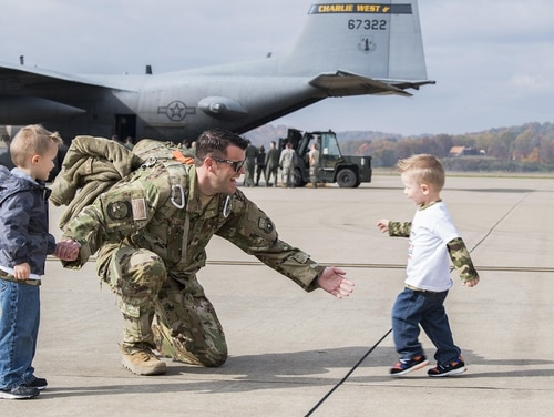 Airmen from the 130th Airlift Wing return home to McLaughlin Air National Guard Base, Charleston, W.Va., after a deployment to Afghanistan in November 2017. (Airman Caleb Vance/Air Force)