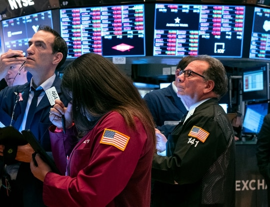 Traders work on the floor of the New York Stock Exchange. Financial markets have become volatile during an ongoing coronavirus pandemic. (Craig Ruttle/AP)