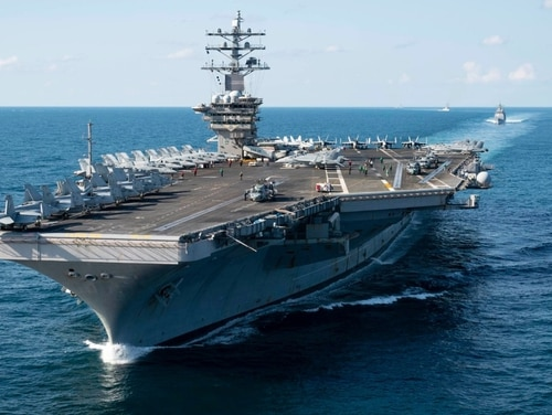 The aircraft carrier Dwight D. Eisenhower sailed in the Atlantic Ocean on Sept. 28. Norfolk authorities arrested three of the crew members following a brawl during the command's holiday party. (Mass Communication Specialist 3rd Class Kaleb J. Sarten/Navy)
