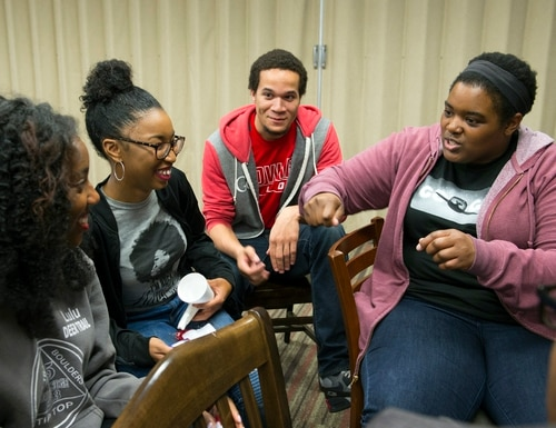 Google software engineer and Google In Residence Sabrina Williams, right, talks with students including, from left, freshmen Lucretia Williams, Alanna Walton, and Christopher Hocutt, during a Google Student Development class on Impostor Syndrome at Howard University in Washington, Tuesday, April 14, 2015. In ongoing efforts to diversify Silicon Valley's tech sector, Google is embedding engineers at a handful of Historically Black Colleges and Universities where they teach, mentor and advise on curriculum. (AP Photo/Molly Riley)