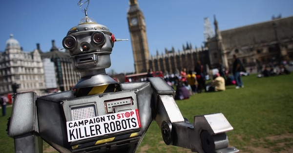 A robot distributes promotional literature calling for a ban on fully autonomous weapons in Parliament Square on April 23, 2013, in London. (Oli Scarff/Getty Images)