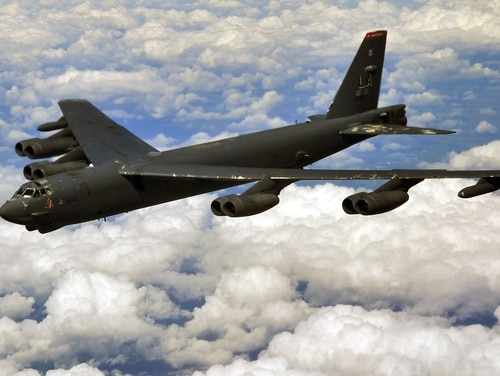 A B-52 Stratofortress deployed to RAF Fairdford, England, from Barksdale Air Force Base, La., prepares to refuel midair with a KC-135 Stratotanker from RAF Mildenhall, England, over the U.K. on June 11, 2014. (Senior Airman Christine Griffiths/U.S. Air Force)