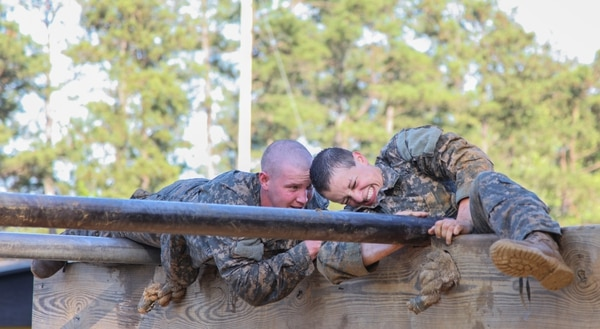 U.S. Army Soldiers conduct the Darby Mile buddy run and an obstacle course during the Ranger Course on Fort Benning, Ga., April 21, 2015. Soldiers attend Ranger school to learn additional leadership and small unit technical and tactical skills in a physically and mentally demanding combat simulated environment. (U.S. Army photo by Pfc Antonio Lewis/Not Released)