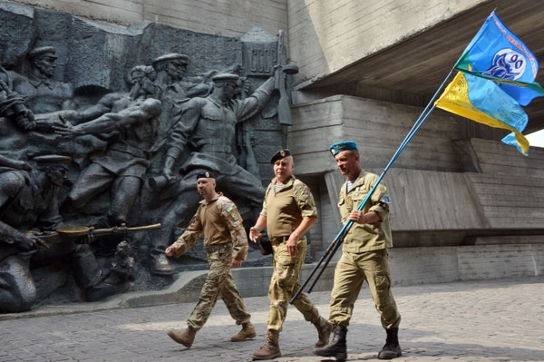 Ukrainian servicemen walk at the WWII memorial during a welcome ceremony in Kiev on September 4, 2015 as paratroopers of the 81st Assault brigade arrived after serving on the frontline in eastern Ukraine. AFP PHOTO/GENYA SAVILOV (Photo credit should read GENYA SAVILOV/AFP/Getty Images)