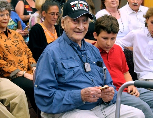 Retired Army Capt. Martin Gelb, 98, holds his Congressional Gold Medal given to him Monday, June 25, 2018, in Derry, New Hampshire. Gelb was honored for his World War II service with the Office of Strategic Services, the precursor to the Central Intelligence Agency. (AP Photo/Holly Ramer)