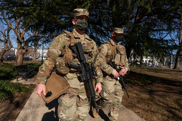Armed members of the Maryland National Guard secures the perimeter around the U.S. Capitol, Wednesday, Jan. 13, 2021, in Washington. (Manuel Balce Ceneta/AP)