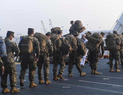 Marines assigned to the 31st Marine Expeditionary Unit (MEU) depart the quarterdeck of amphibious assault ship USS America (LHA 6) in support of Exercise Cobra Gold 2020 (CG 20). (Mass Communication Specialist Seaman Jonathan Berlier/Navy)