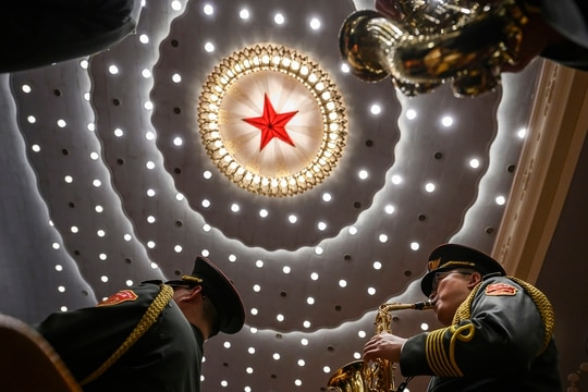 Chinese soldiers from the People's Liberation Army band play the national anthem at a ceremony marking the 70th anniversary of China's entry into the Korean War, on Oct. 23, 2020, at the Great Hall of the People in Beijing, China. (Kevin Frayer/Getty Images)