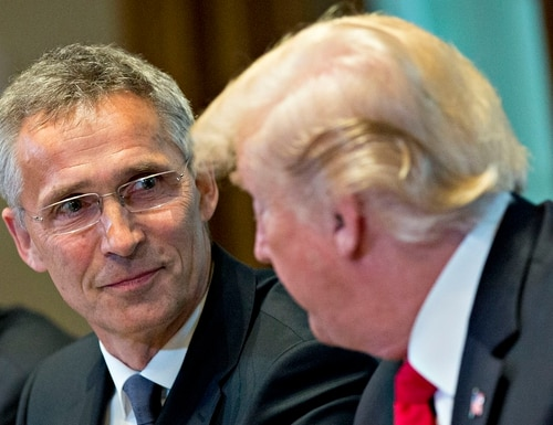 NATO Secretary General Jens Stoltenberg, left, listens as U.S. President Donald Trump, right, speaks during a meeting in the Cabinet Room of the White House in Washington on May 17, 2018. (Andrew Harrer/Bloomberg via Getty Images)