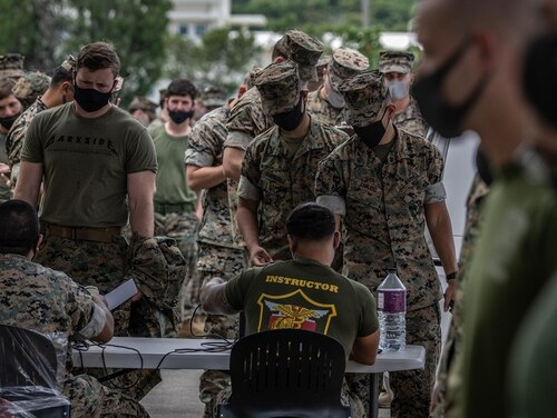 United States Marines queue to receive the Moderna coronavirus vaccine at Camp Hansen on April 28, in Kin, Japan. (Carl Court/Getty Images)