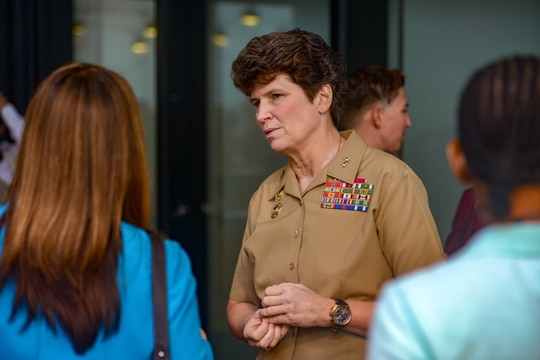 Major General Lori Reynolds, commander of Marine Corps Forces Cyberspace Command, speaks with a fellow attendee at the Women of America's