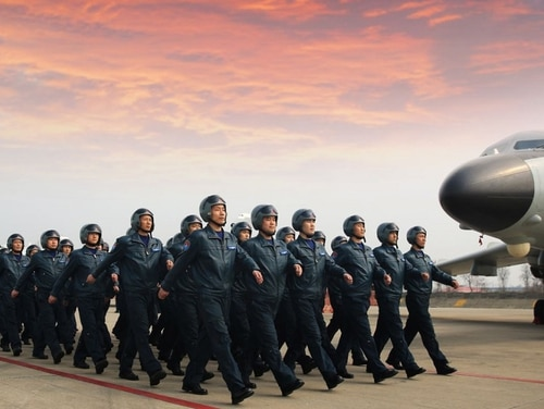 Chinese airmen march in formation prior to a combat drill with H-6K bombers. (Yang Ruikang/People's Republic of China)